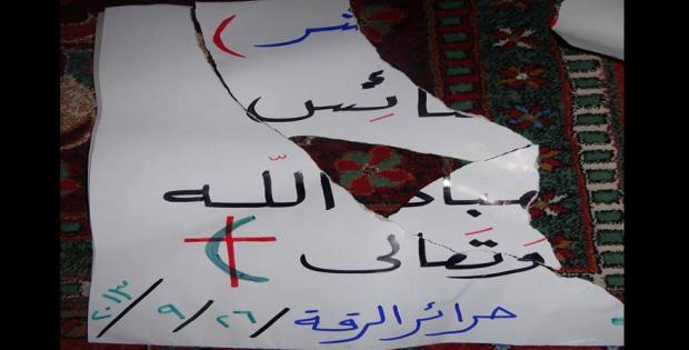 Suad Nofal's banner, in which she showed solidarity with the Christian population, torn by ISIS. Source: Suad Nofal´s facebook page