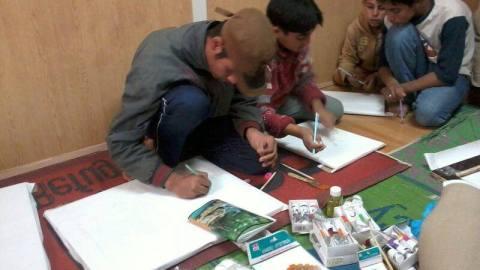 أطفال يرسمون في الزعتري. المصدر: الصفحة الرسمية للفعالية