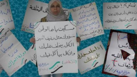 Raqqa activist Suad Nofal with her one-woman demonstration´s banners. Used with permission.