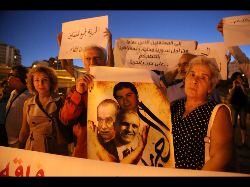 Fadwa at protest for the freedom of detainees(20/9/14) 2nd anniversary of comrades' enforced disappearance. All rights reserved.