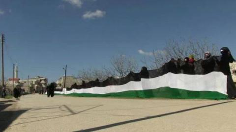 Syrian Women Weave the Biggest Revolutionary Flag in Protest Against All Terror