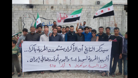 بالصور: لافتات كفرنبل تحيي الكرد وتسخر من الدكتاتور