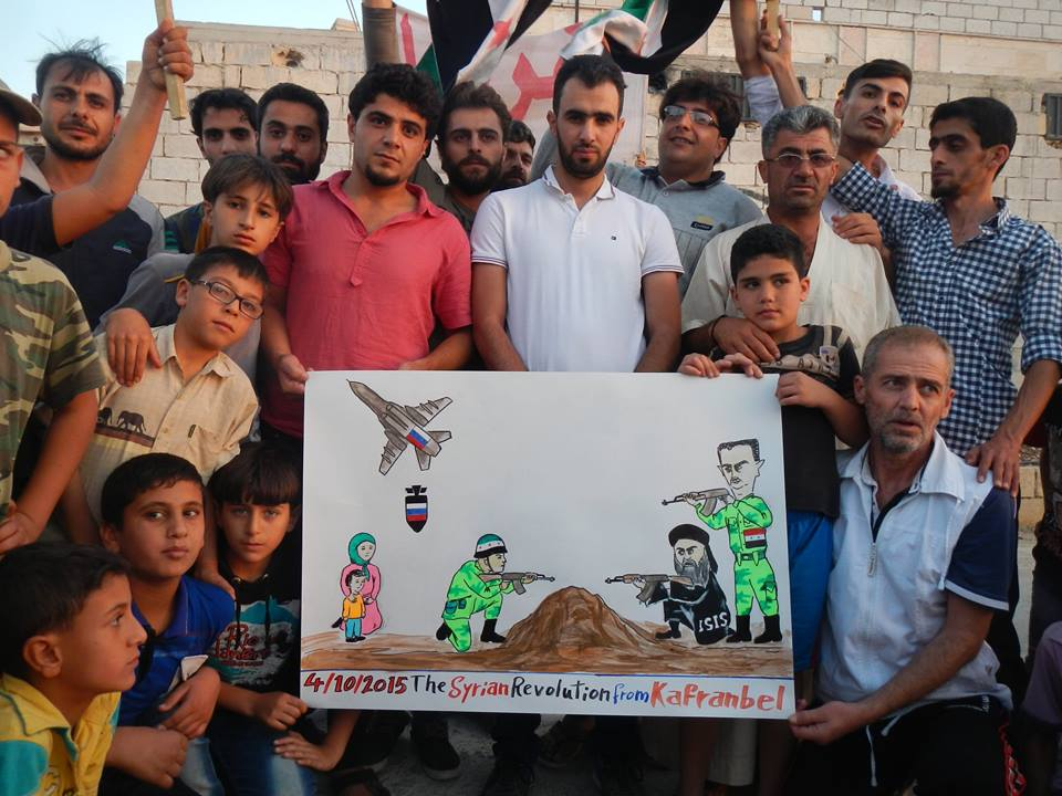 Caricature raised by Kafranbel's activists during a protest against Russian intervention/Activist Raed Fares's Facebook