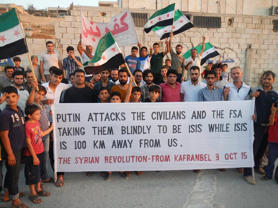 Banner held up by protestors in Kafranbel against Russian intervention in Syria/Activist Raed Fares's Facebook page