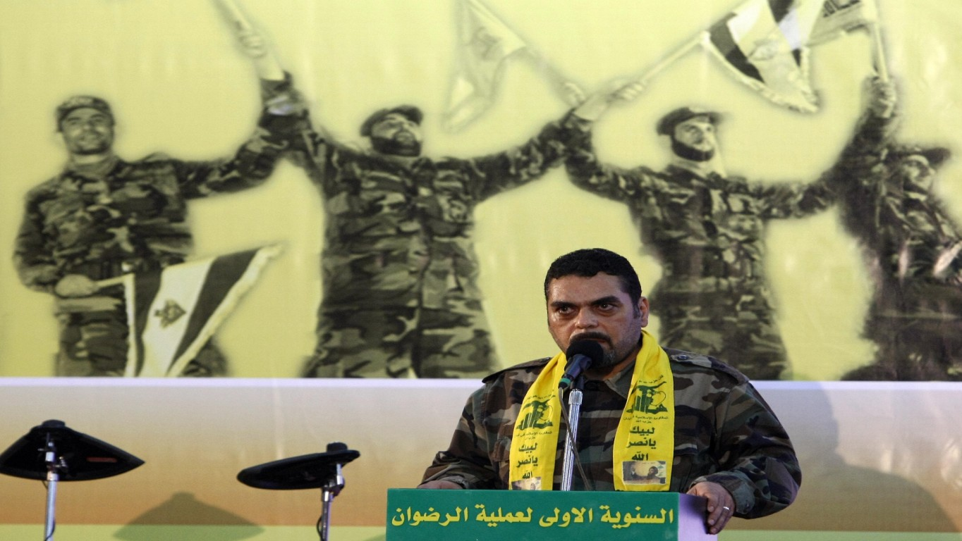 Lebanese Samir Kantar, a prisoner freed by Israel during a prisoner swap, speaks during a celebration marking the first anniversary of the swap between Hezbollah and Israel, in Beirut on July 17, 2009. The July 16, 2008 prisoner swap included the return of 199 bodies, along with the release of the remaining five Lebanese prisoners in Israel. In exchange, Hezbollah handed over the bodies of two Israeli soldiers captured in a cross-border raid on July 12, 2006, sparking a devastating 34-day war. AFP PHOTO/ RAMZI HAIDAR (Photo credit should read RAMZI HAIDAR/AFP/Getty Images)