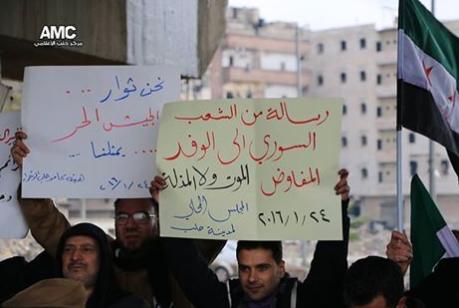 لافتة تندد بمؤتمر جنيف3، المصدر: شبكة الثورة السورية، فيس بوك.