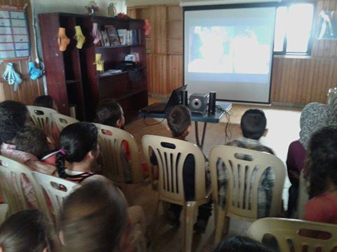 [Photo: Part of a film screening for children at ʿObour Association - Tartus (ʿObour Association's Facebook page)].