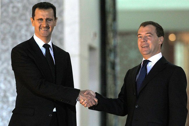 [Photo: Bashar al-Asad with Russian Prime Minister Dmitry Medvedev - Syria - 10-5-2010 (Kremlin.ru/CC BY 4.0 via Wikimedia Commons)].