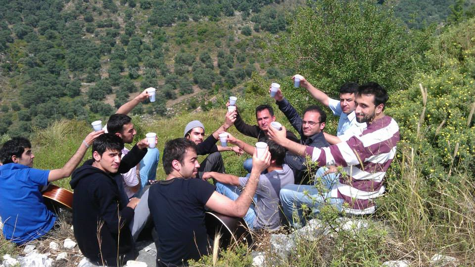 [Photo: Suleiman's friends toasting in his memory, one year after his death. (SyriaUntold)].