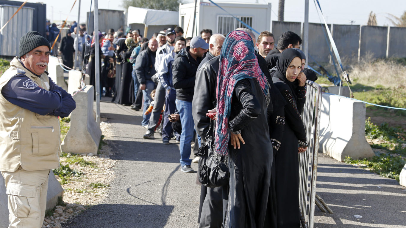 [Photo: Line of refugees in front of the UNHCR registration center in Tripoli - Lebanon - 8-1-2014 (Mohamed Azakir/World Bank/via CC BY-NC-ND 2.0)].