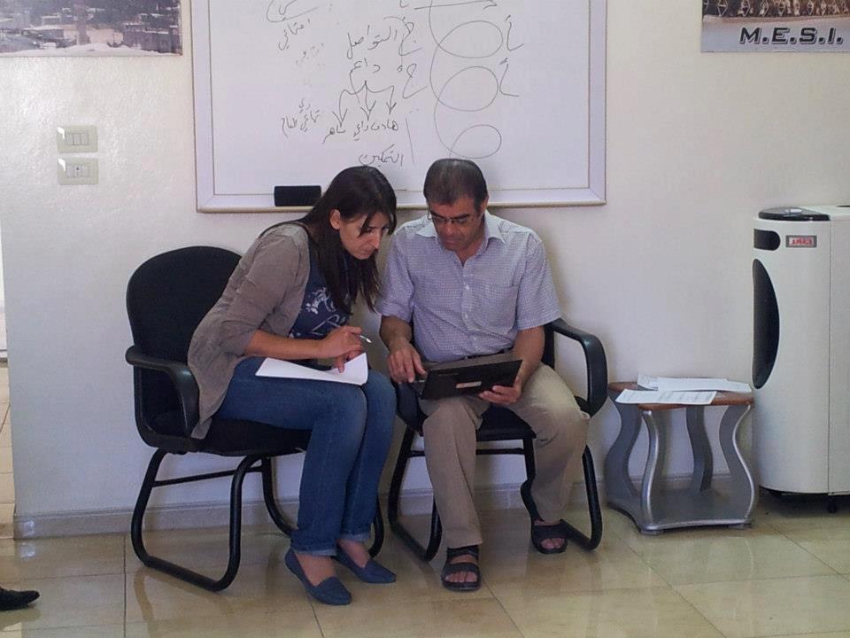 [Photo: Dr. Jalal Nofal with psychologist Wifa' al-Hayek - Yabrud - Rif Dimashq - 7-9-2012 (Yabrud Ahl al-Khayr Facebook Page)].