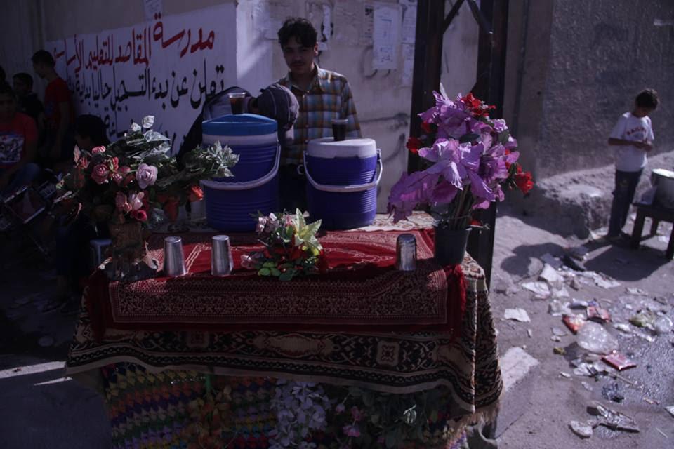 [Photo: Tamarind Juice Seller in al-Qabun - Damascus - ʻAid al-Adha (Sept 12-14) 2016 (Rafia Salamah/SyriaUntold)].