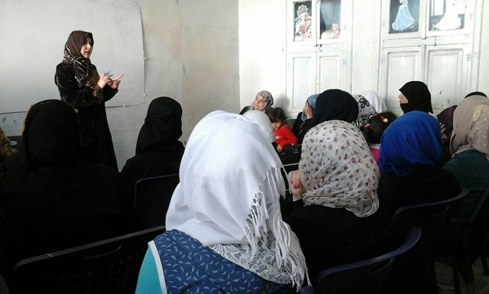[Photo: Women take part in one of the seminars organized by the Mazaya Center - Kafranbel - Idlib - 24-10-2016 (Mazaya Center Facebook page)].